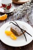 Yummy Poppy cake with orange on white plate Stock Photos