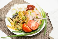 Yummy pork meat with potatoes, vegetable and sauce Stock Photos