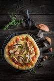 Yummy rustic pizza with noble mushrooms and thyme Royalty Free Stock Images