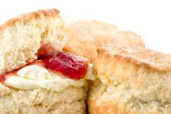 Yummy Scones. Delicious fresh baked scones with jam & cream on white background Stock Photos