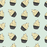 Yummy seamless pattern with sweet hand drawn color cupcake. Royalty Free Stock Images