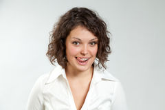 Yummy sexy brunette. Curly girl playing with her tongue Royalty Free Stock Photos