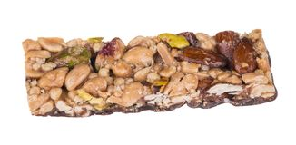 Yummy stick with almonds, pistachios and peanuts royalty free stock photo