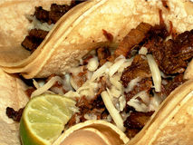 Yummy Tacos. Beef Tacos with shredded cheese and lime stock photo