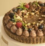 Chocolate Tart with nuts, blueberries and rasberries stock images