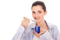 Yummy, tasty yogurt. Isolated shot,  woman eating yogurt, yummy, tasty, close up Stock Photos