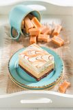Yummy toffee cake with fudge bars on blue porcelain. On white background Stock Photography