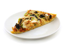 Yummy vegetable pizza. Vegetable pizza slice with tomato sauce, peppers and olives Stock Photo