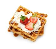 Yummy Waffles With Whipped Cream, Strawberries And Caramel Syrup On White Background Royalty Free Stock Photography