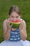Yummy Watermelon. Child eating a large wedge of watermelon outside in the summer Stock Photography