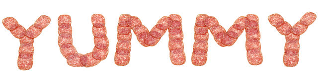 Yummy word made from salami stock photography