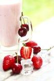 Yummy yogurt with strawberries and cherries Royalty Free Stock Photos