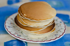 Yummy-yummy!. Yummy homemade pancakes are laying on a vintage floral plate Royalty Free Stock Images
