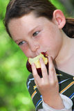Yung girl eating apple Royalty Free Stock Photo