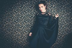 Yung girl wearing black evening dress Royalty Free Stock Image