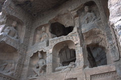 Yungang Caves, Datong, China. HDR picture of the Yungang caves containing buddha's and boddhisattva's. Through the holes in the wall a large buddha statue can be Stock Photography