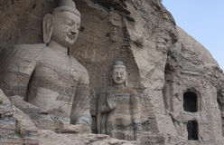 Yungang Caves in Datong, China. Picture of the Yungang caves containing buddha's and boddhisattva's. UNESCO world Heritage Site Royalty Free Stock Photo