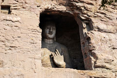 Yungang Grottoes. The Yungang Grottoes are ancient Chinese Buddhist temple grottoes near the city of Datong Royalty Free Stock Photo