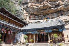 YUNNAN, CHINA - BRENG 21 2015 IN DE WAR: De Baoxiangtempel in Shibaoshan zet op Stock Afbeeldingen