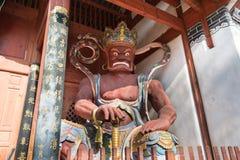 YUNNAN, CHINA - 20 DE MARÇO DE 2015: Templo de Xingjiao em Shaxi vi antigo Fotos de Stock
