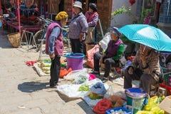YUNNAN, CHINA - MAR 20 2015: Market at Shaxi Ancient village. a Royalty Free Stock Photo