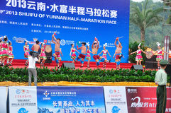 Yunnan ethnic dance performances. Before the marathon race is about to begin, the yunnan ethnic dance performances.Half international marathon in fushui county Royalty Free Stock Image
