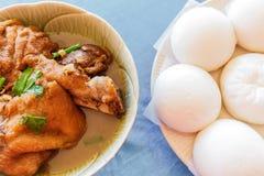 Yunnan pork leg stewed in the gravy with mantou Stock Image