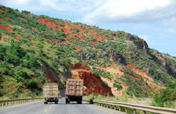 Yunnan Province, China: Trucks on Highway Stock Photo