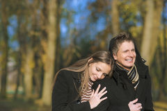 Yuong caucasian couple walking in the park Stock Photo