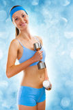 A yuong sporty girl with dumbbels Royalty Free Stock Images