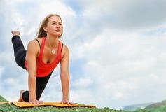 Yuong woman makes flexible yoga exercise Stock Image