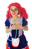 Yup!  I Have a Heart. A living young rag doll happily listening to her heart with a stethoscope.  On a white background Stock Images