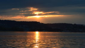 Yup thats a sun set. Sun is setting on a small lake town Stock Photography