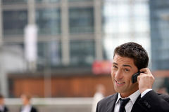 Yuppie businessman making a call Stock Image