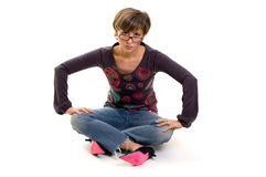 Yuppie girl sitting on the floor Stock Image