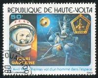 Yuri Gagarin. BURKINA FASO CIRCA 1978: stamp printed by Burkina Faso, shows Yuri Gagarin and moon landing, circa 1978 Royalty Free Stock Photography