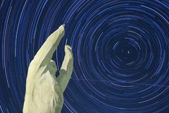Yuri Gagarin monument. Baikonur. Startrails background. The stars are moving in a circle. Polar star in the center royalty free stock photos