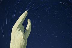 Yuri Gagarin monument. Baikonur. Startrails background. The stars are moving in a circle. Polar star in the center royalty free stock photo