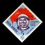 Yuri Gagarin, soviet astronaut, 1st man in the space, red soviet flag, Romania, circa 1964, Stock Photos