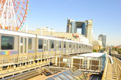 Yurikamome train that connects mainland Tokyo with the Odaiba Island through the Rainbow bridge. While travelling within the big steel structure of Rainbow Royalty Free Stock Photo