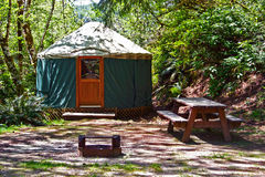 Yurt Camping in the Woods. A rustic yurt in the woods Royalty Free Stock Photo