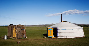 Yurt with clouds. Traditional home of Mongolian people - yurt - located in central Mongolia stock image