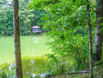 A Yurt on the lake shore in Fort Yargo State Park. A blue Yurt, nestled in the trees on the lake in Fort Yargo State Park in Winder, Georgia on a sunny day in Royalty Free Stock Photography