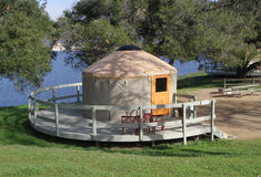 Yurt Living with Large Porch. Yurt Camping at a pristine lake with large deck porch Stock Photo
