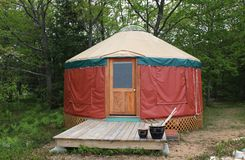 Yurt in Paradise. Small Yurt on forest edge with deck and nice cedar door Royalty Free Stock Images
