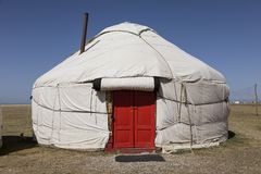 Yurt with red door at Song Kul lake. In Kyrgyzstan royalty free stock photography