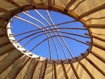 Yurt roof. A window hole inside the roof of a white yurt Stock Image
