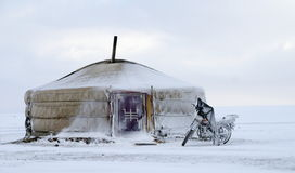 Yurt in the snow with a motorcycle in mongolia Royalty Free Stock Image