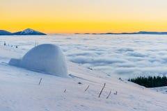 Yurt at sunset in winter fog mountains Royalty Free Stock Image
