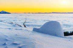 Yurt at sunset in winter fog mountains Stock Photography